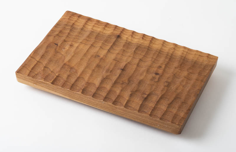 Textured surface trivet, in cherry