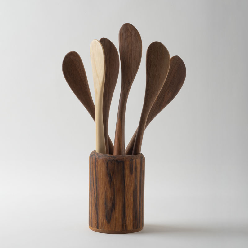 Collection of Peanut butter knives in a zebrawood pot